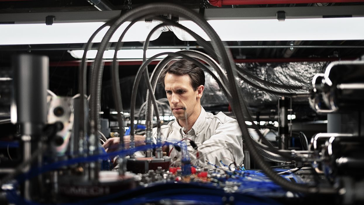A man working on a quantum computer
