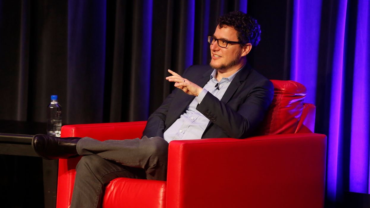 Eric Ries, sitting in a red chair