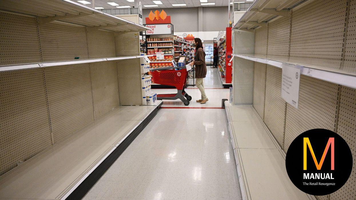 A shopper walks past empty shelves in the paper products aisle of a store in Burbank, California, November 19, 2020. - Paper towels and other cleaning supplies are flying off retail shelves amidst a new wave of panic buying as the country faces the most recent recent surge in coronavirus infections. (Photo by Robyn Beck / AFP) (Photo by ROBYN BECK/AFP via Getty Images)