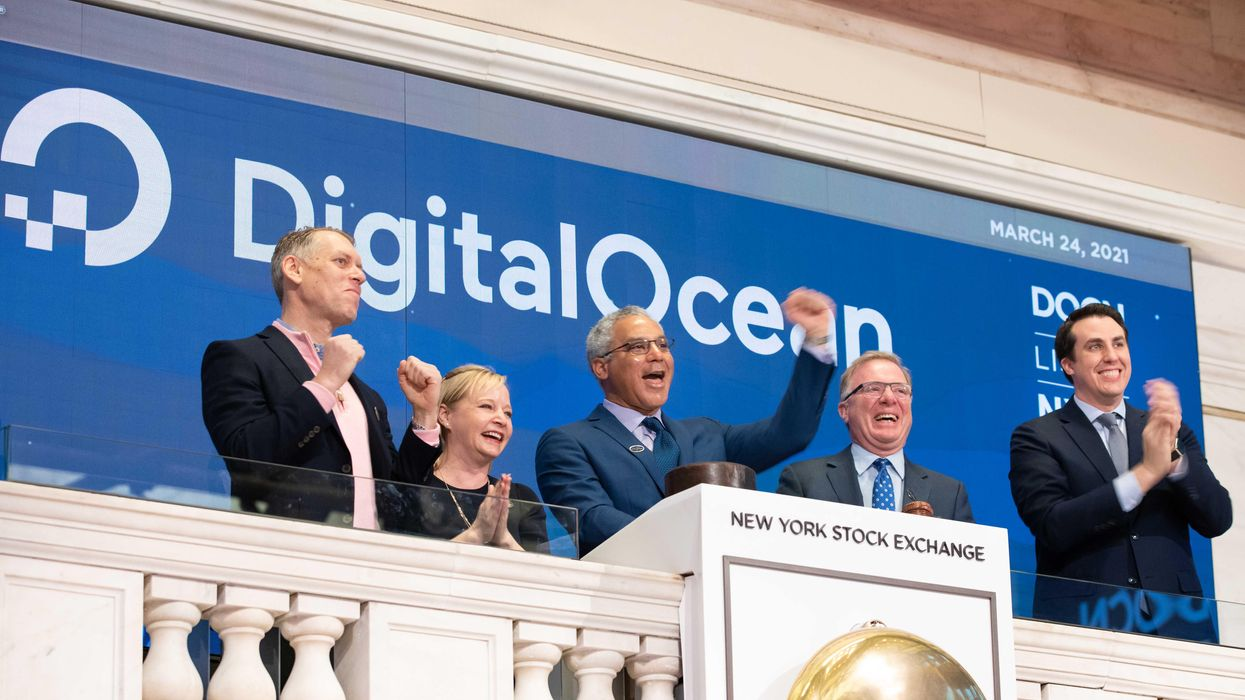 DigitalOcean CEO Yancey Spruill (center) rings the opening bell at the New York Stock Exchange on Wednesday, March 24, 2021.
