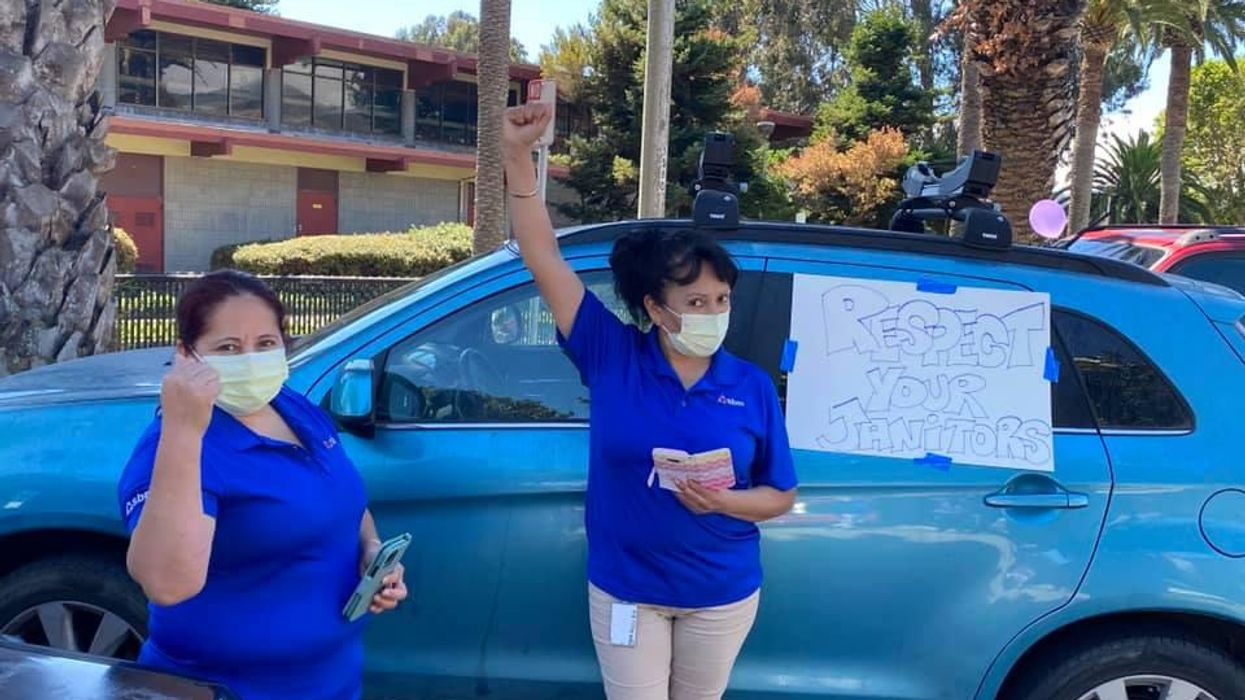 Service workers in Silicon Valley protest layoffs.