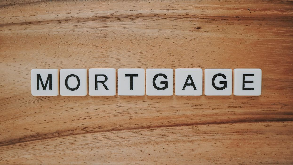 """""""Mortgage"""" spelled out on Scrabble tiles."""