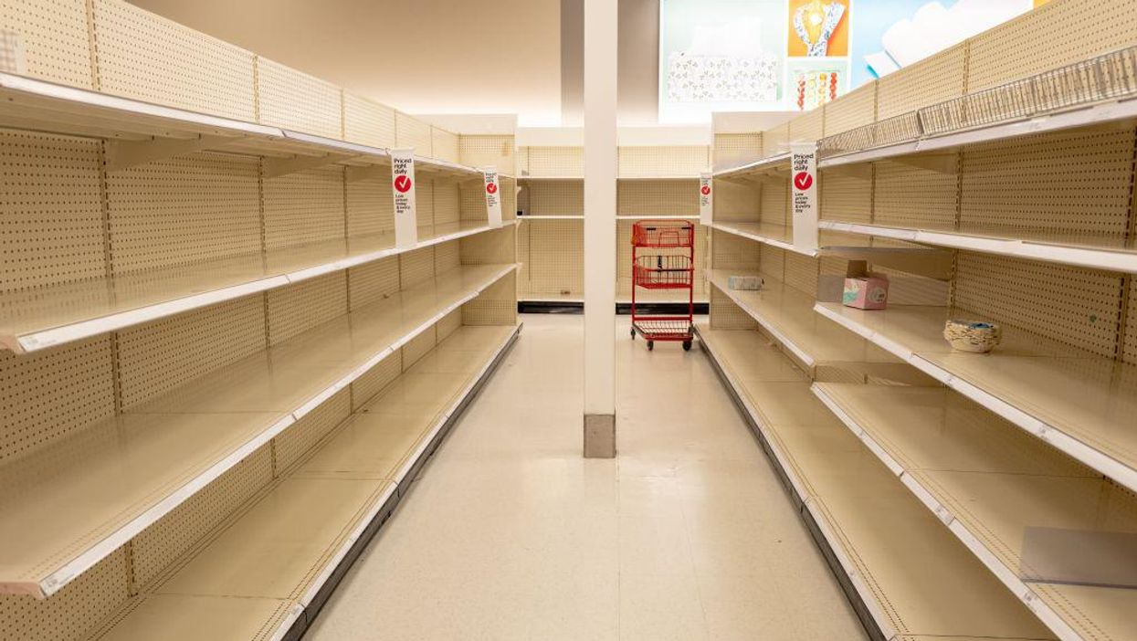 Store aisle with empty shelves
