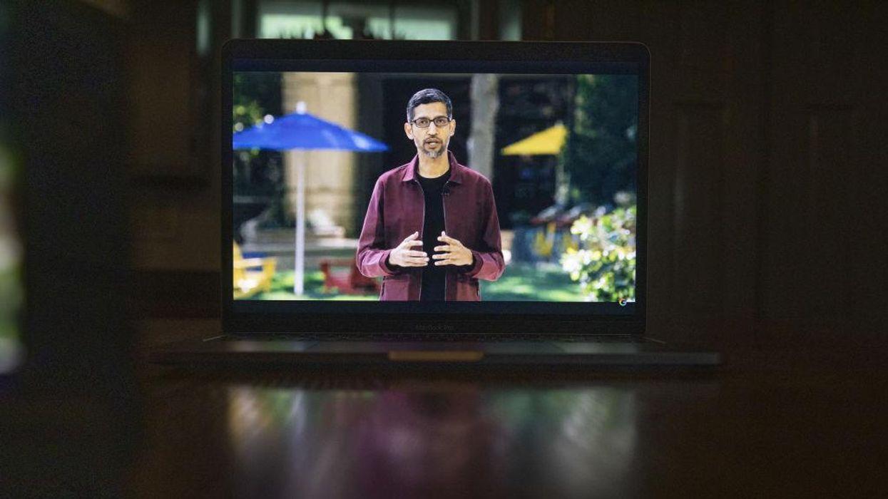 CEO Sundar Pichai wearing a purple jacket and talking on a screen