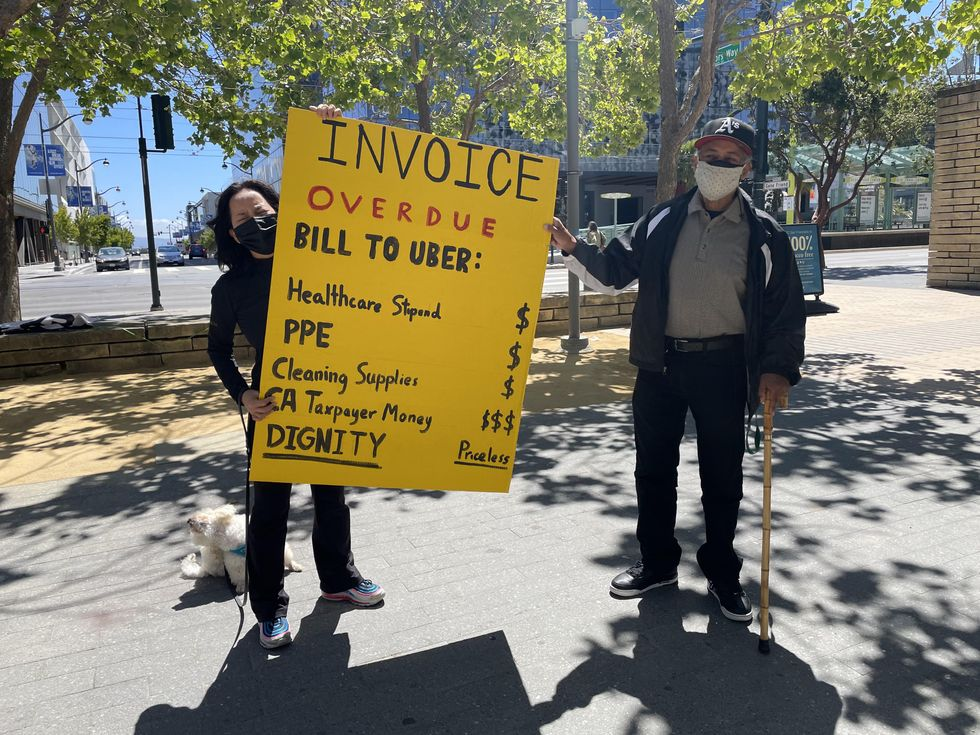 Gig workers hold a sign at a protest in San Francisco.