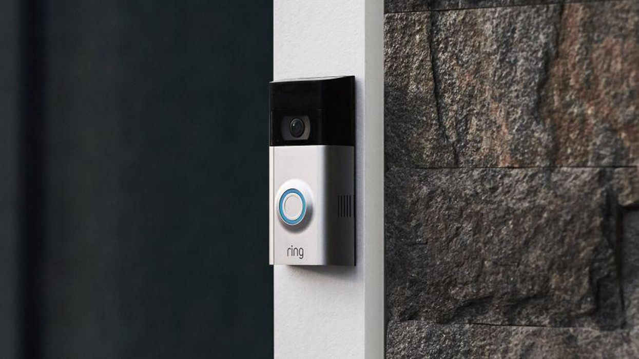 A Ring doorbell mounted on a house