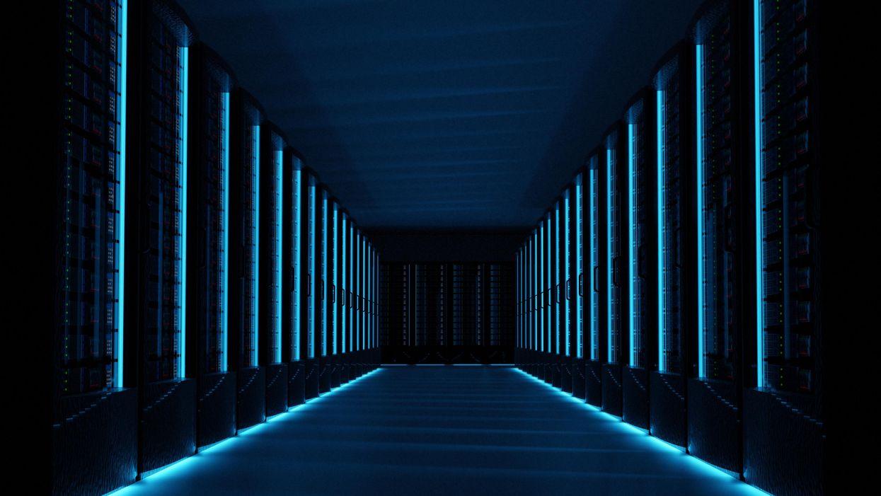 Row of darkened storage cabinets in a datacenter.