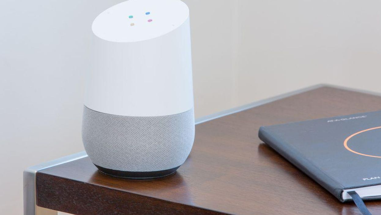 A Google Home speaker on a table