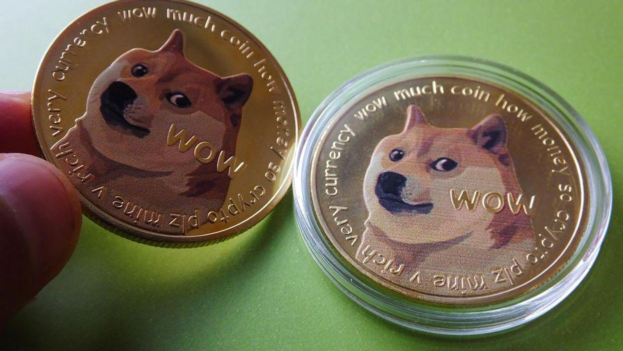 A collectible souvenir represents the dogecoin cryptocurrency.