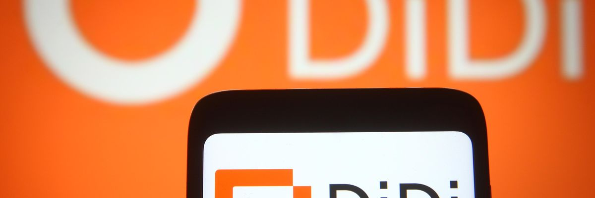 DiDi's logo shown on a rendering of a smartphone