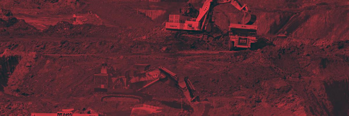 trucks digging in coal mine