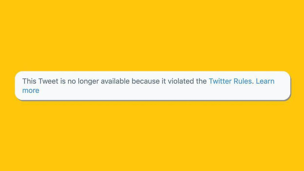 A Twitter warning saying that a tweet is no longer available because it violated the service's rules.