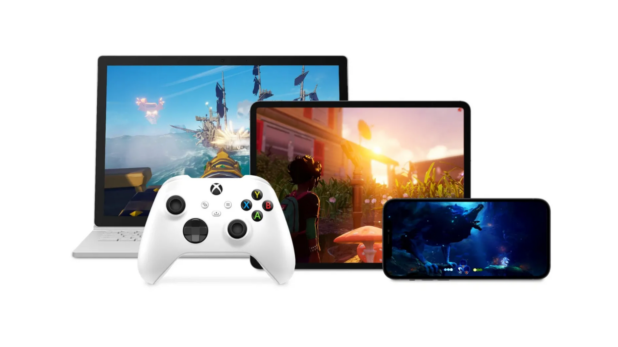 An image of an Xbox controller sitting next to an iPhone, iPad and Chromebook laptop.