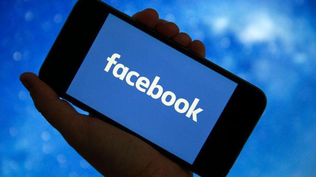 An illustration of a Facebook logo displayed on a smartphone screen
