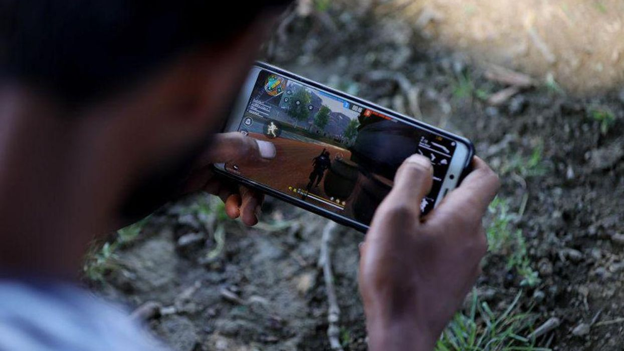 A player competes in the mobile battle royale title Free Fire on an Android smartphone.