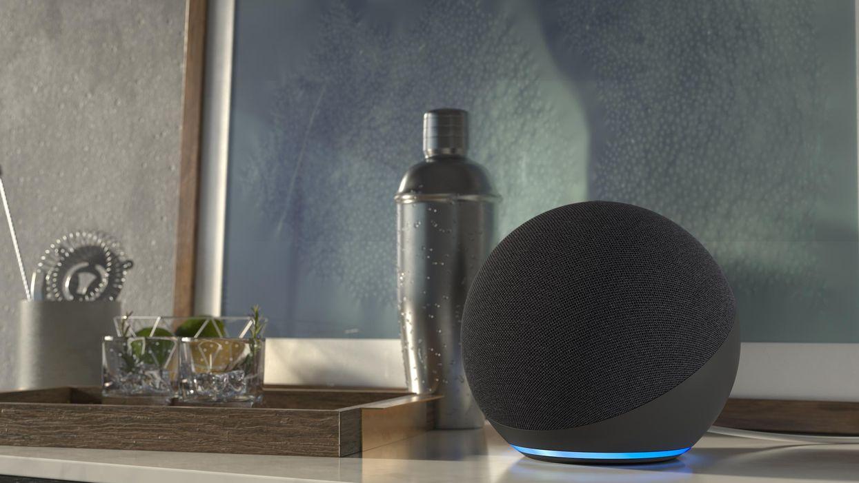 An Amazon Echo on a bar table.
