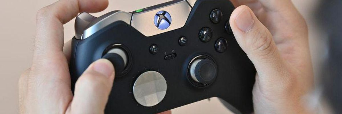 A close-up of an Xbox controller being held by a player.
