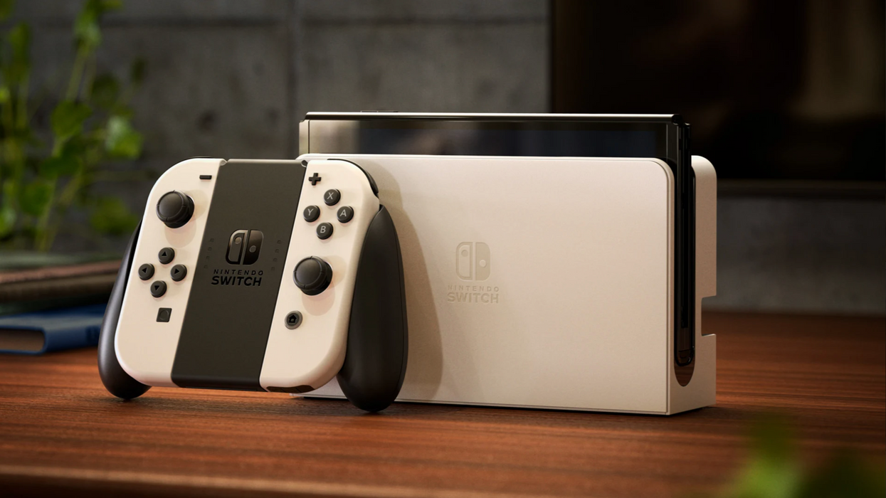An image of the new Nintendo Switch OLED model alongside the docked Joy-Con controllers.