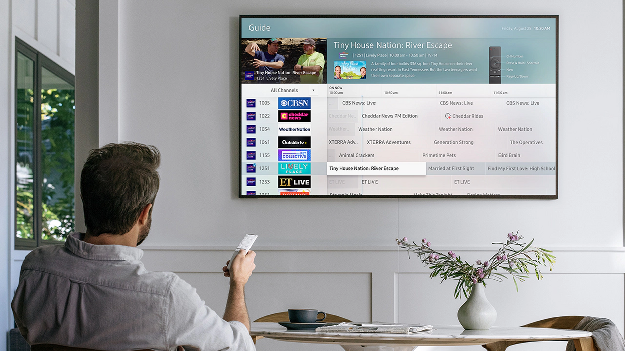 Person browsing Samsung TV Plus service on a TV
