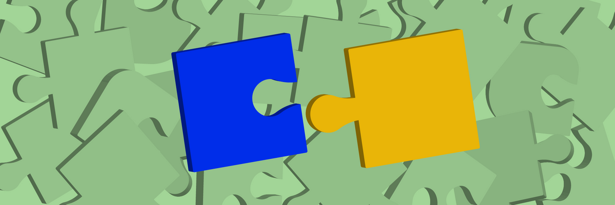 Two interlocking puzzle pieces over a background of other puzzle pieces