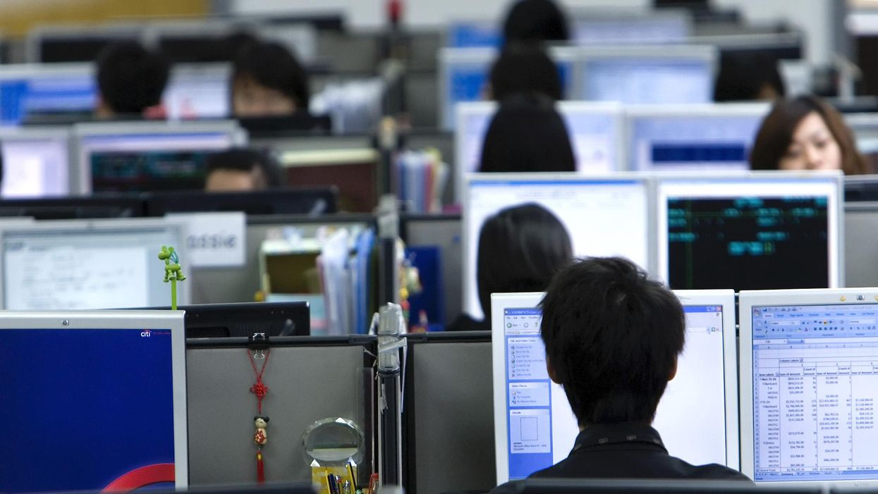 Workers in a Chinese office.