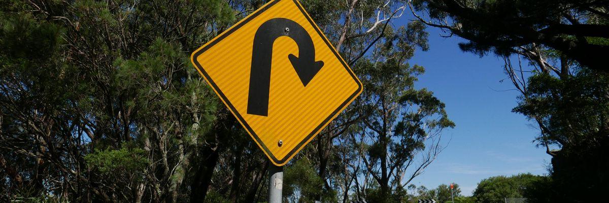 A road sign indicating a U-turn
