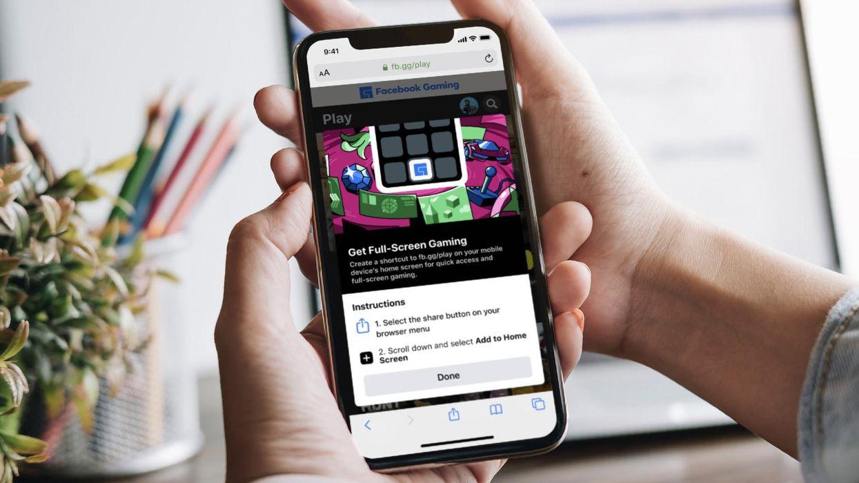 An iPhone running Facebook cloud games via Apple's Safari browser.