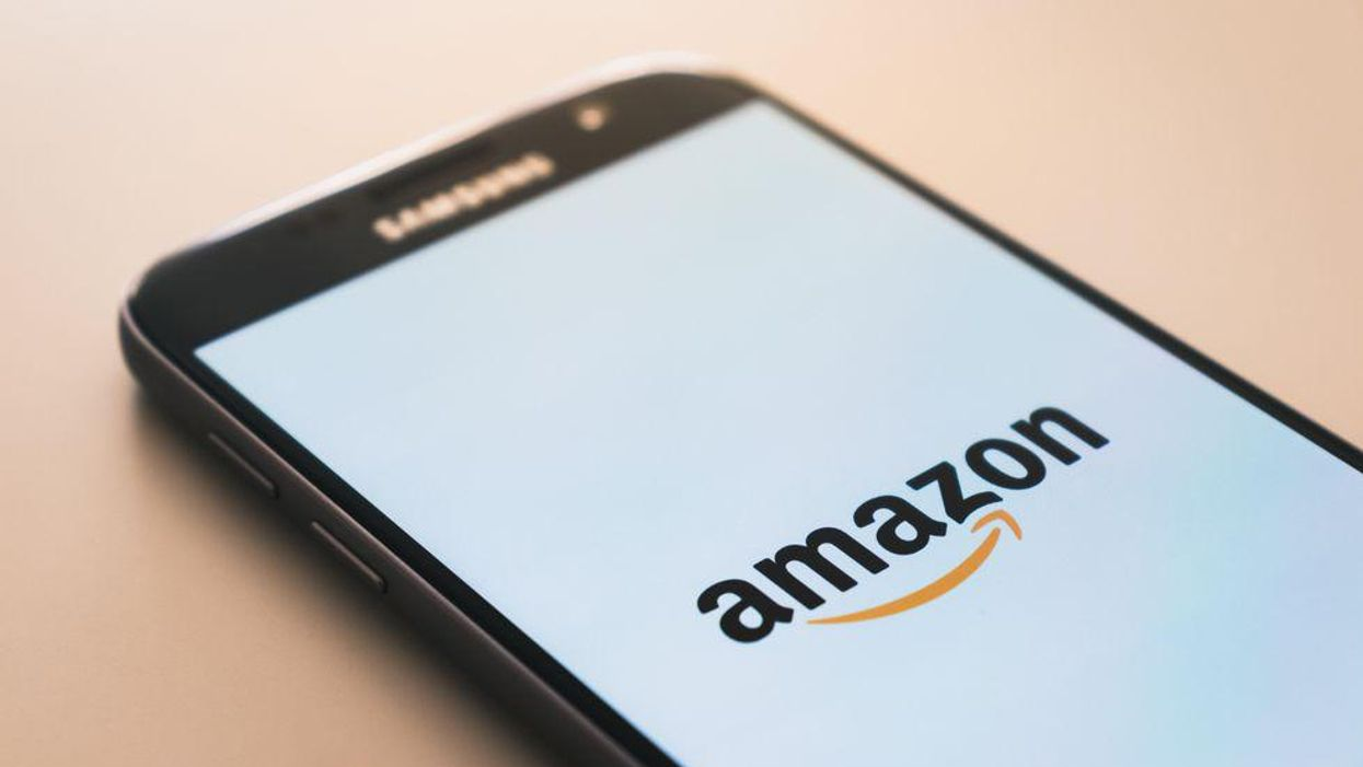 The Amazon logo on a phone.