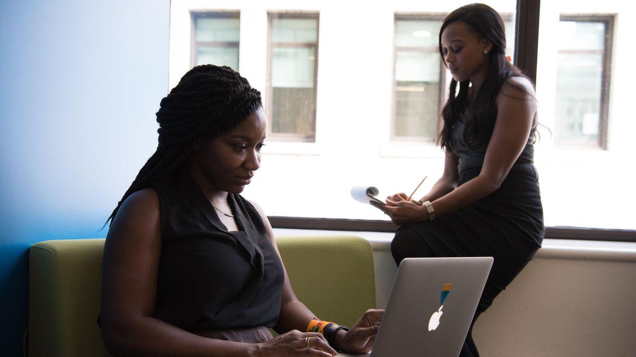 Two Black women working in an office