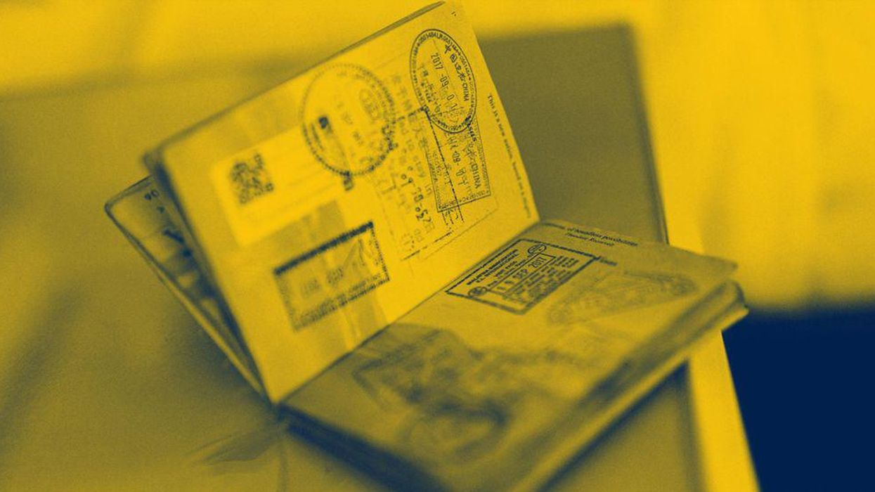 An open passport with stamps