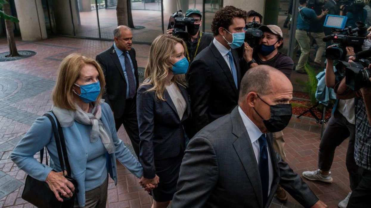 Elizabeth Holmes arriving to court with her defense team.