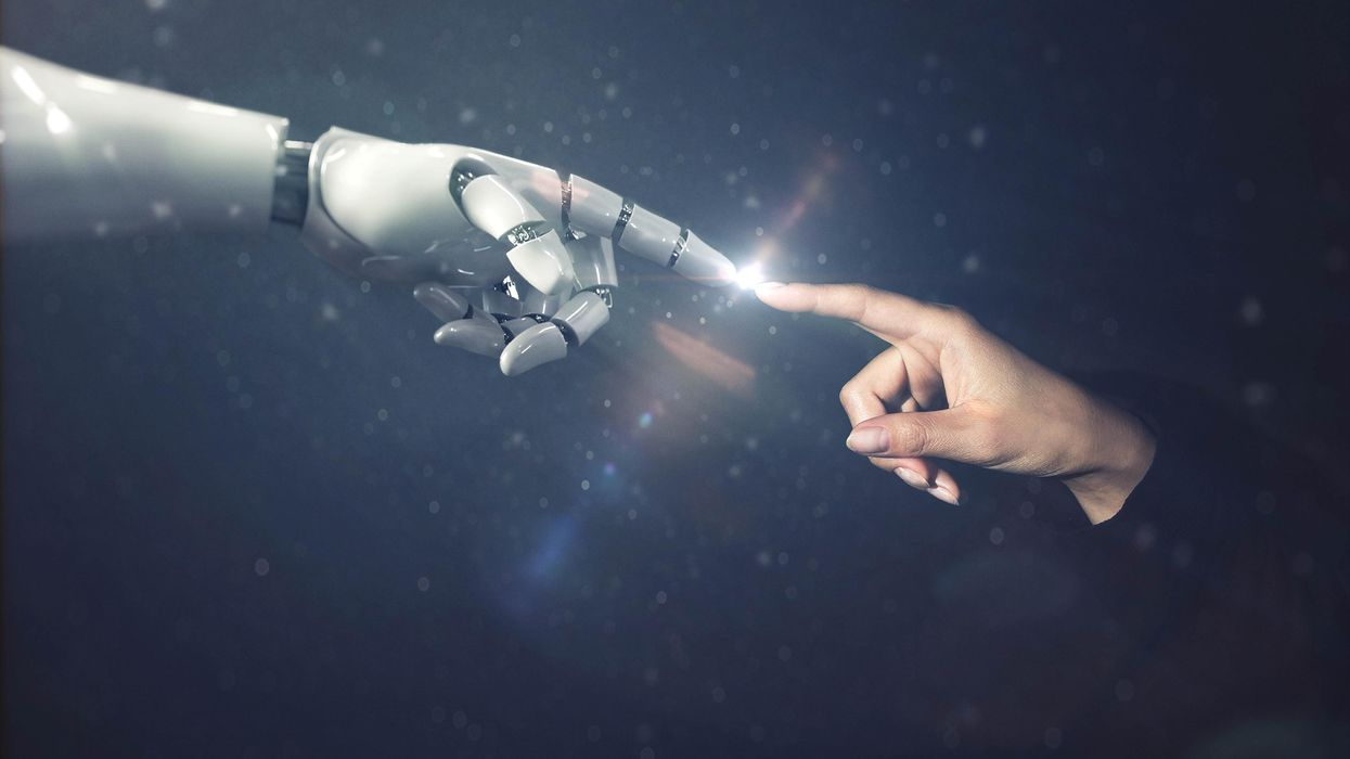 Human hand touching with cybernetics robot