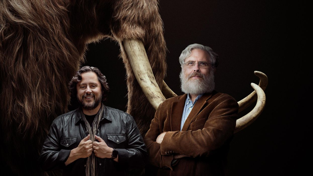 An illustration of Ben Lamm and George Church superimposed in front of a woolly mammoth