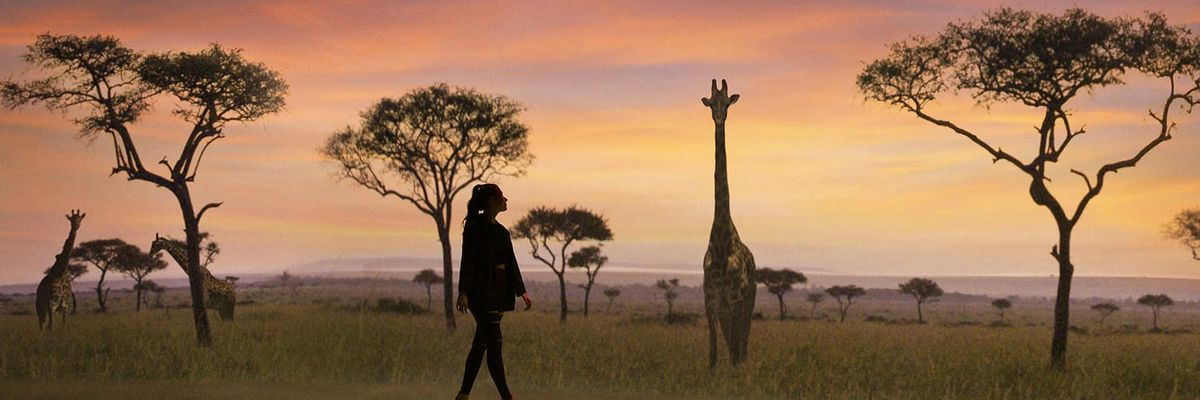 image of woman walking in front of safari projection