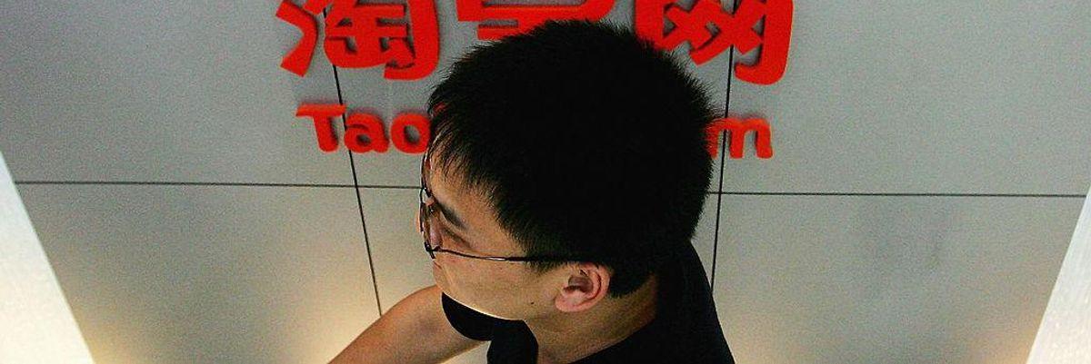 Man below Alibaba logo