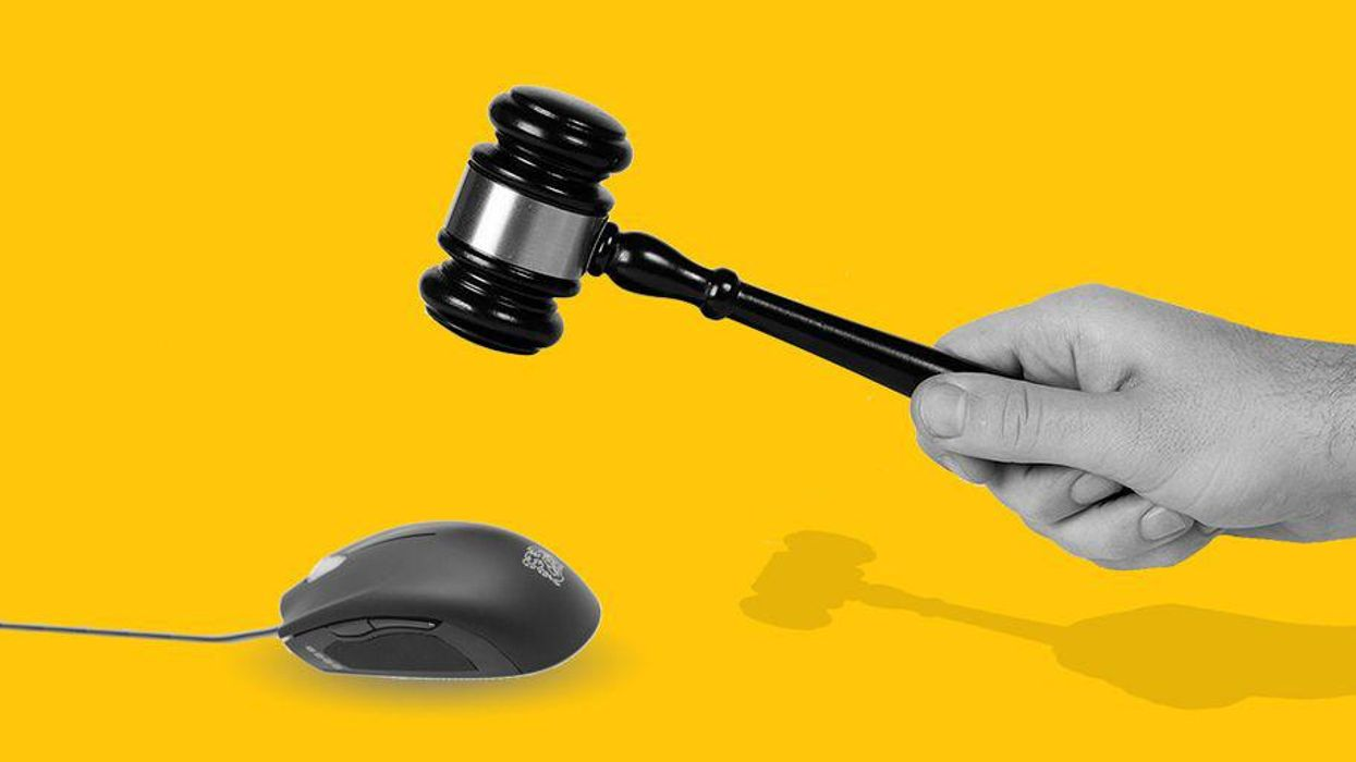 A graphic of a gavel being brought down on a computer mouse