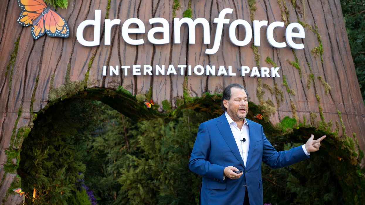 Marc Benioff in front of a sign for Dreamforce International Park