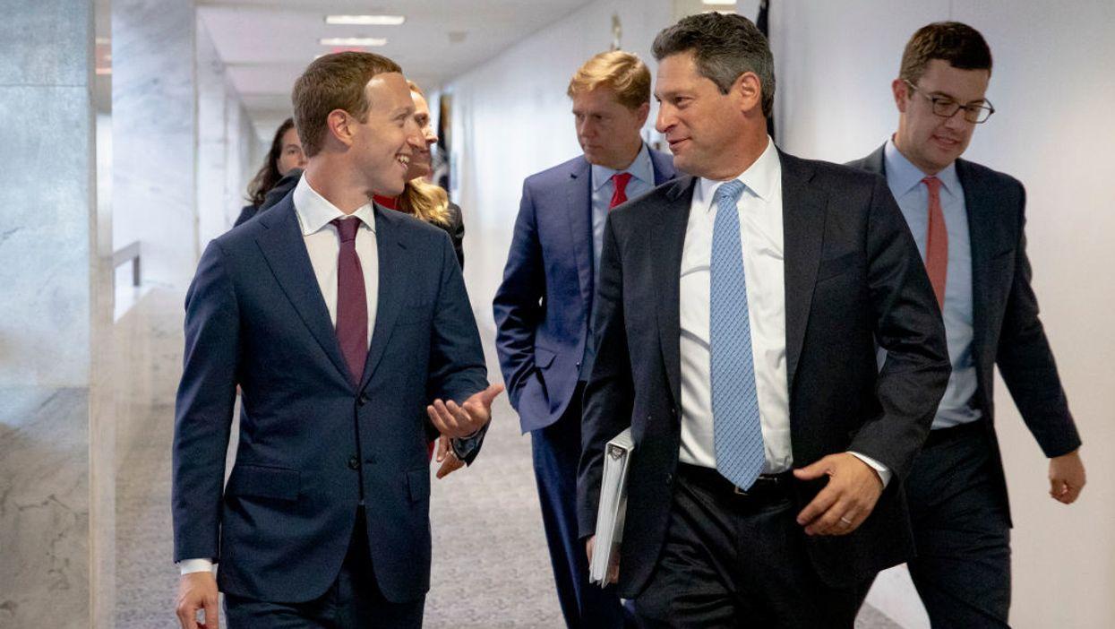 Mark Zuckerberg, Joel Kaplan and Andy Stone walking down a hall