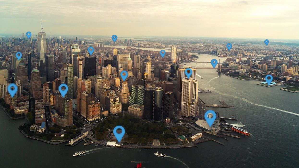 New York skyline with blue cartoon-like pins sticking out of buildings