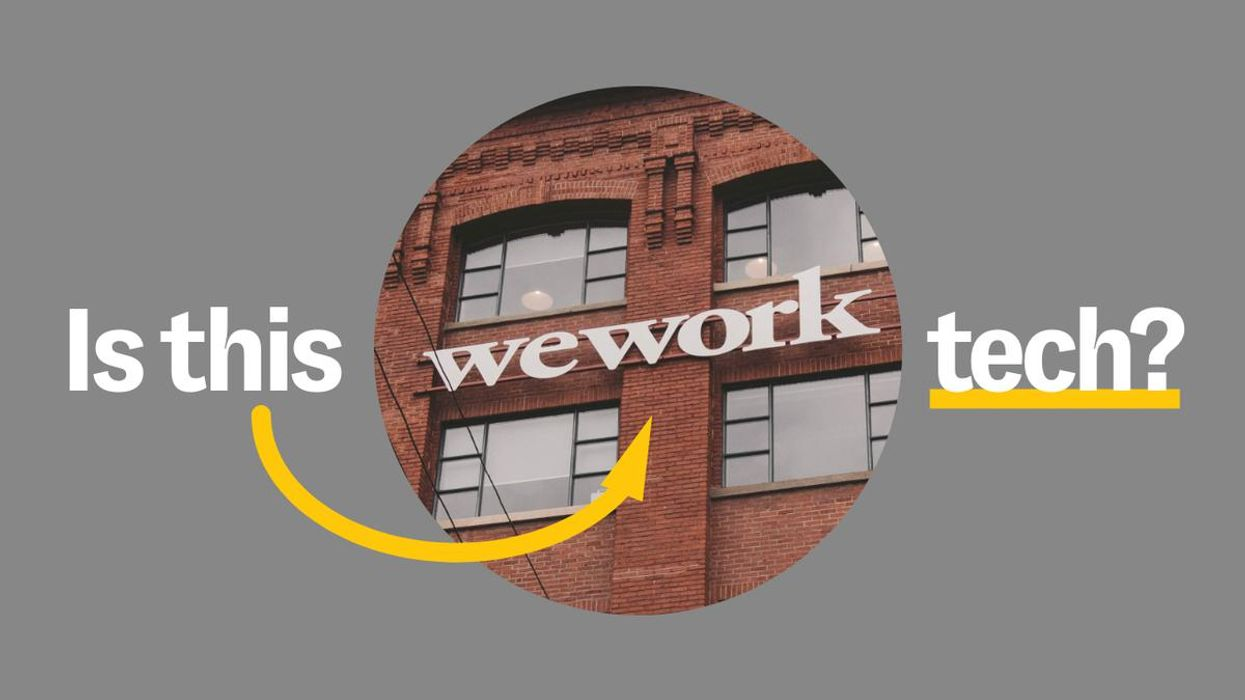 Picture of brick building with WeWork logo on it.