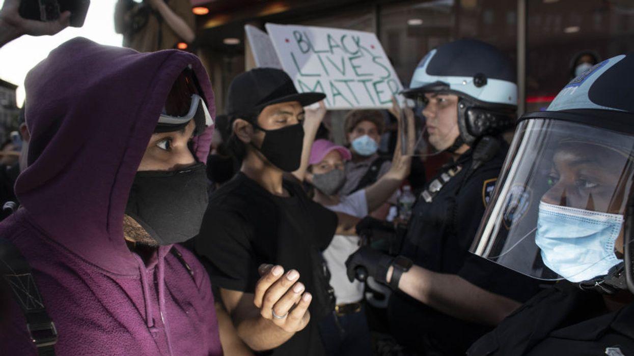 Police officers intervene in protests, held against the police killing of George Floyd in Minneapolis, in New York last night.