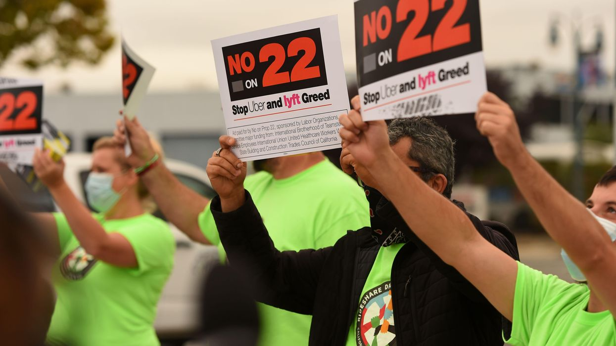 Protestors hold No on 22 signs