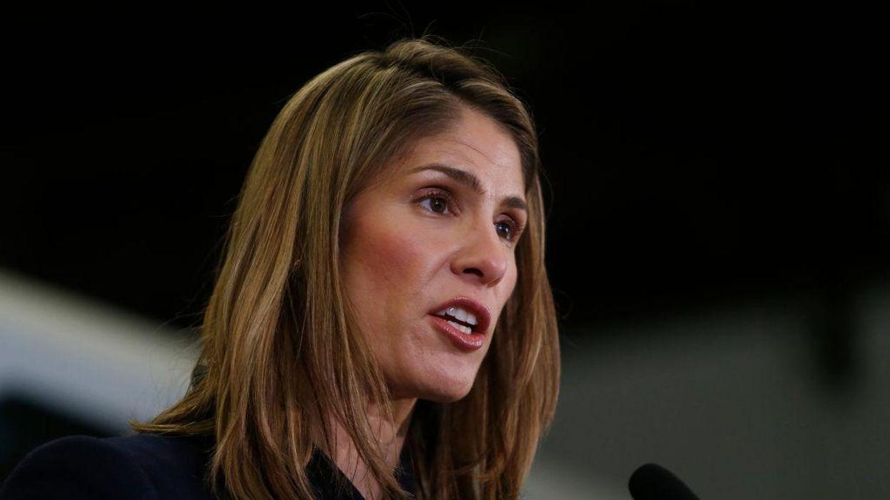 Representative Lori Trahan at a microphone
