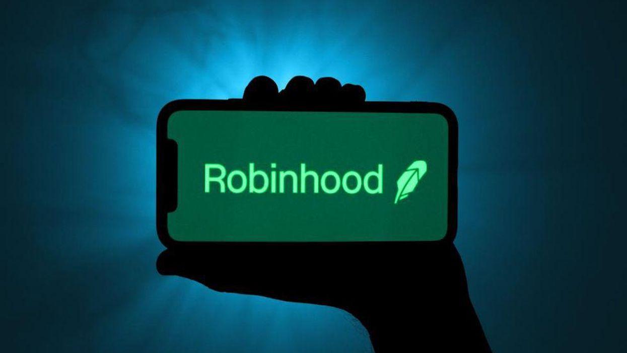 Hand holding phone with Robinhood app