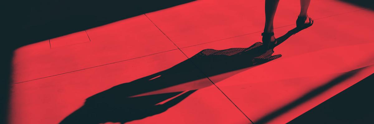 shadow of person walking on sidewalk