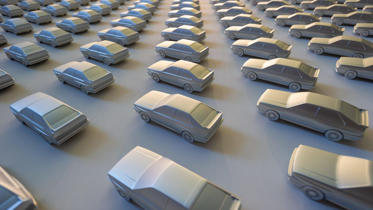 Rows of model cars on a white background.