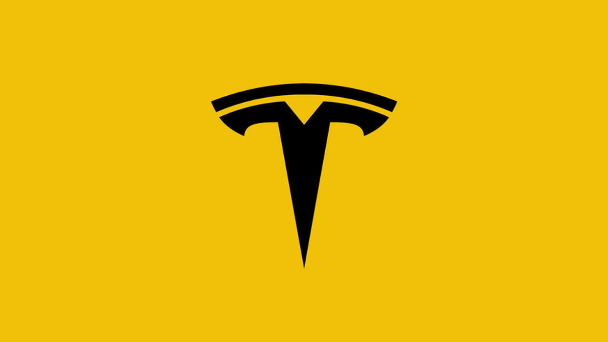 The Tesla logo on a yellow background.