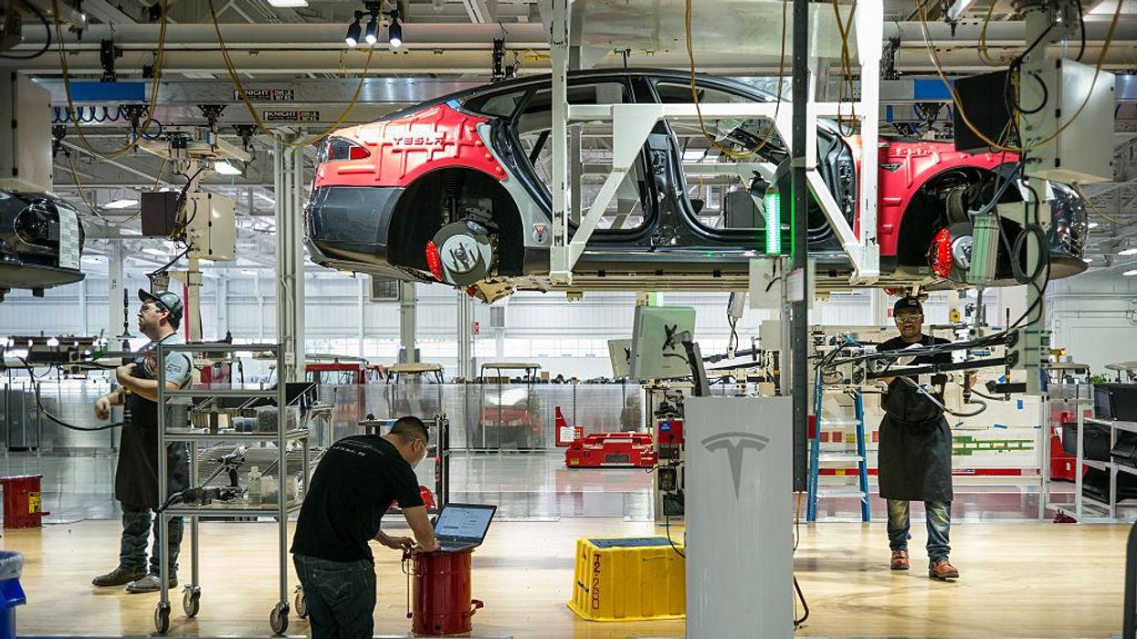Tesla workers on the line in Fremont, California