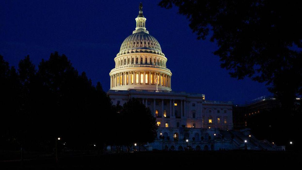 The U.S. Capitol dome lit up at night.