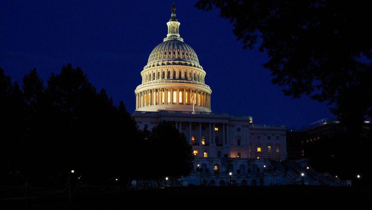 The U.S. Capitol lit up at night.
